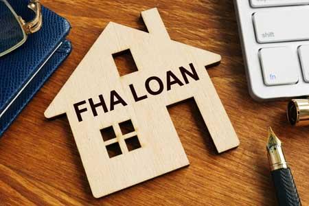 FHA loan written on the model of home.